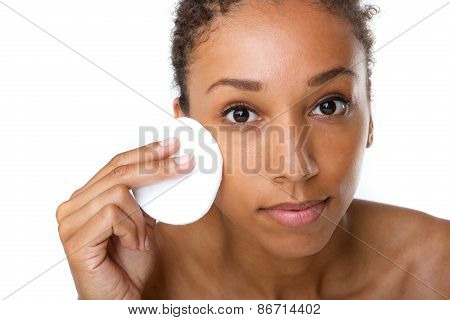 African American Woman Removing Makeup With Sponge