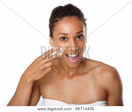 Smiling African American Woman Applying Lotion On Skin