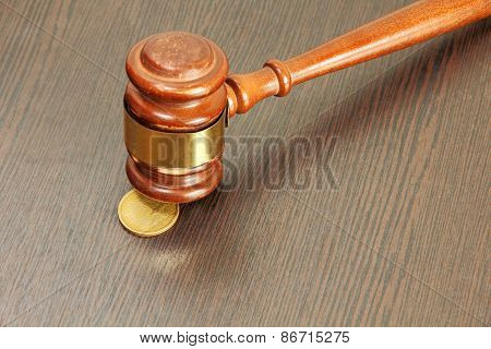 Auction Hammer Or Judge Gavel And One Dollar Coin  Taken Closeup