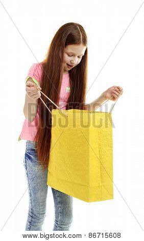 Beautiful little girl with shopping bag, isolated on white