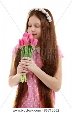 Beautiful little girl with flowers, isolated on white