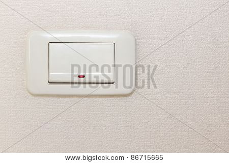 Light Switch On Beige Wall.