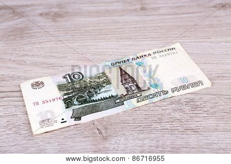 One denomination on wooden background