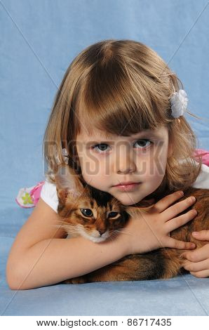 Smiling Portrait Of Little Girl With Kitten