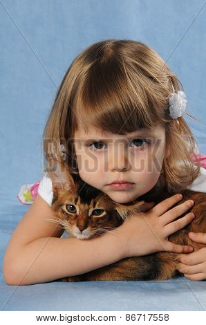 Little Girl Lying With Somali Kitten Ruddy Color