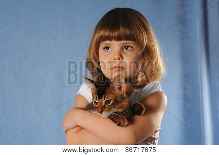 Sad Little Girl With Kitten