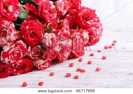 Beautiful roses on table close-up