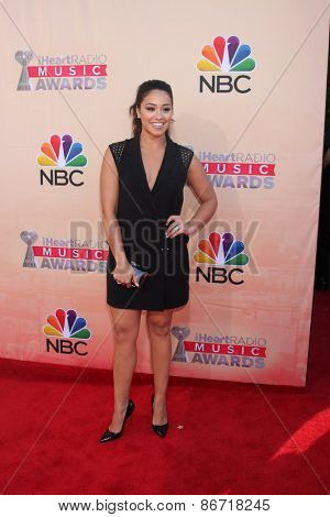 LOS ANGELES - MAR 29:  Gina Rodriguez at the 2015 iHeartRadio Music Awards at the Shrine Auditorium on March 29, 2015 in Los Angeles, CA