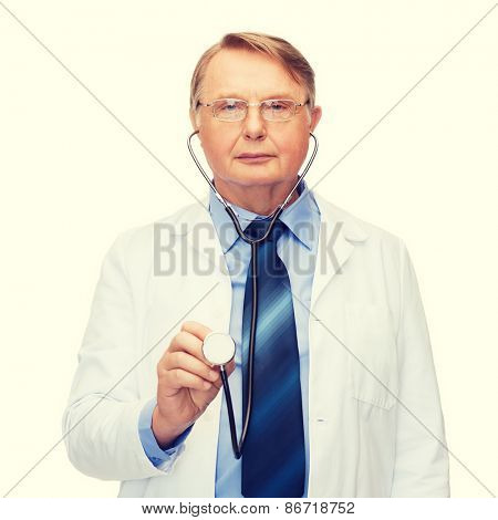 healthcare and medicine concept - smiling standing doctor in eyeglasses or professor in eyeglasses with stethoscope