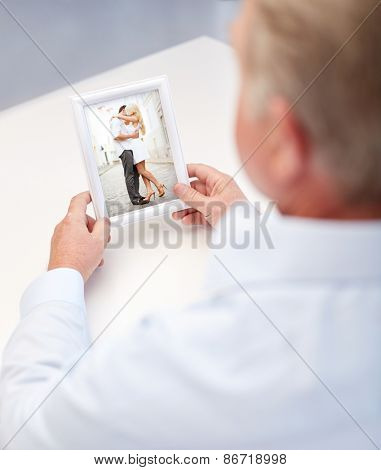 oldness, memories, nostalgia and people concept - close up of old man holding and looking at happy young couple photo