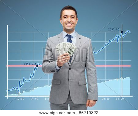 business, people, success and finances concept - smiling businessman with american dollar money over growing chart and blue background
