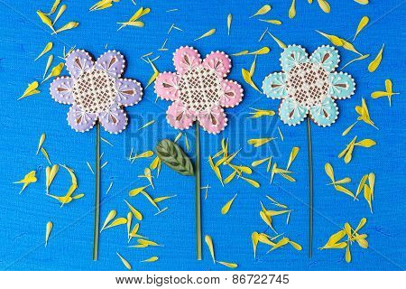 Flowers Shaped Cookies Decorated With Ornaments On Blue Background