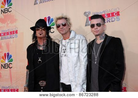 LOS ANGELES - MAR 29:  Nikki Sixx, James Michael, DJ Ashba at the 2015 iHeartRadio Music Awards at the Shrine Auditorium on March 29, 2015 in Los Angeles, CA