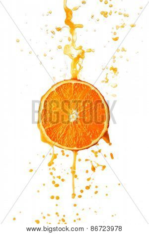Orange juice splashing on slice isolated on white background