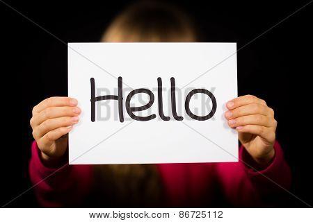 Child Holding Hello Sign