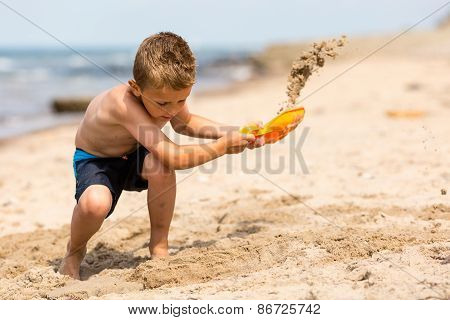 Young Boy With Plastic Shovel