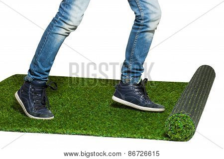 Human Legs Stepping On Artificial Grass Close Up Isolated On White