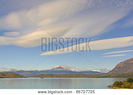 Lenticular Clouds Over An Alpine Landscape