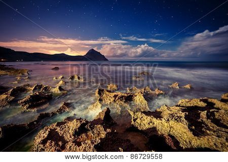 Fantastic view of the nature reserve Monte Cofano. Dramatic scene. Creative lighting. Location cape San Vito. Sicilia, Italy, Europe. Mediterranean and Tyrrhenian sea. Beauty world.