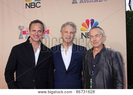 LOS ANGELES - MAR 29:  Tom Poleman, John Sykes, Ian Stewart at the 2015 iHeartRadio Music Awards at the Shrine Auditorium on March 29, 2015 in Los Angeles, CA