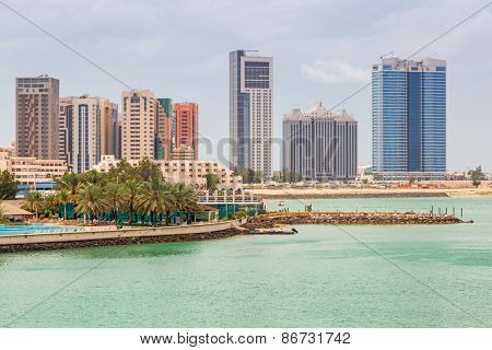 ABU DHABI, UAE - MARCH 26, 2014: Cityscape of Abu Dhabi with skyscrapers, UAE. Abu Dhabi is the capital and the second most populous city in the United Arab Emirates with around 1 million people.