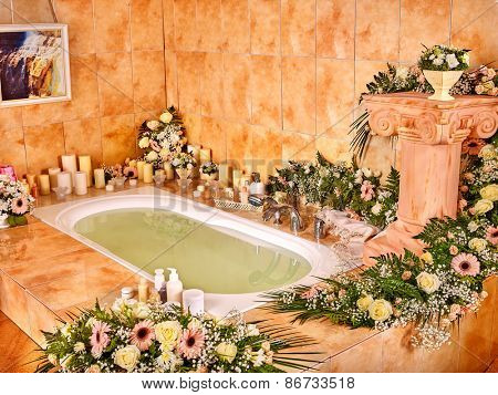 Bathroom interior with bubble bath. Flower spa.