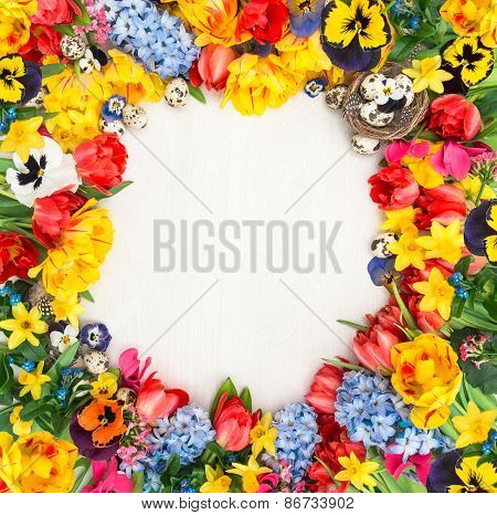 Spring Flowers And Easter Eggs. Tulips, Narcissus, Hyacinth And Pansy