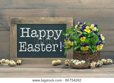 Easter Decoration With Quail Eggs, Pansy Flowers And Vintage Blackboard