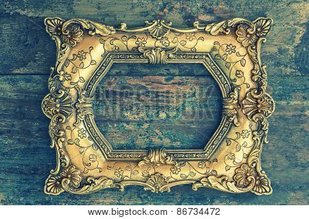 Vintage Baroque Golden Frame On Wooden Background. Grunge Texture