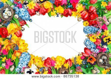 Holidays Background From Spring Flowers And Easter Eggs