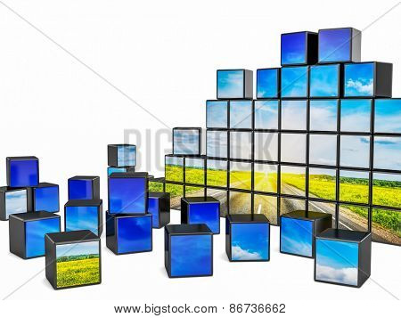 Travel concept background - cubes with beautiful landscape road in blooming spring meadow on sunset  on white