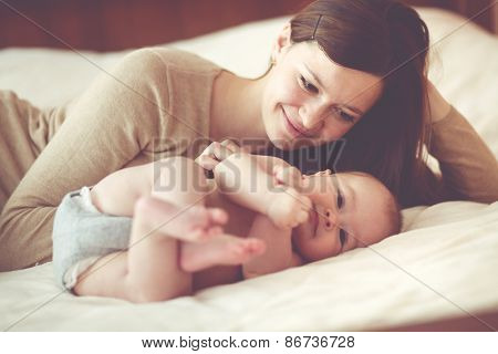 Portrait of a mother with her 4 months old baby
