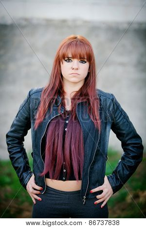 Rebellious teenager girl with red hair very angry