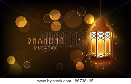 Hanging illuminate lantern on shiny golden background for the celebration of Islamic holy month of prayers, Ramadan Mubarak.