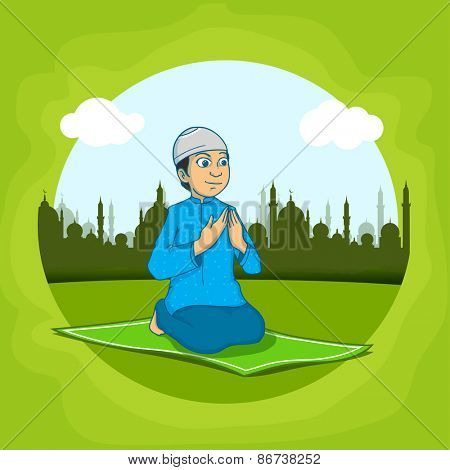 Religious Muslim boy, reading Namaz (Namaz, Muslim prayer) in front of mosque,  Concept for Islamic holy month of prayers, Ramadan Kareem.