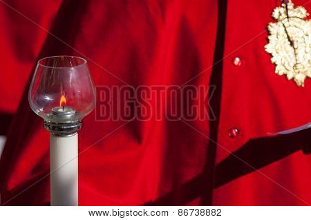 Particular Of A Candelabrum In Front Of A Red Coat