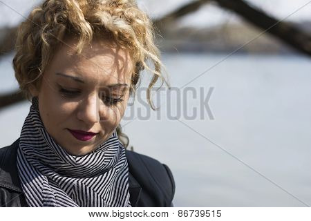Young Curly Blond Womanlooking Down