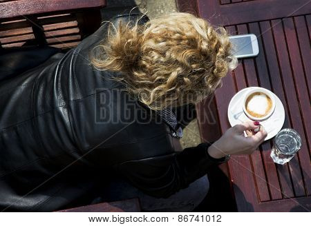 Young Curly Blond Woman Drinking Coffee