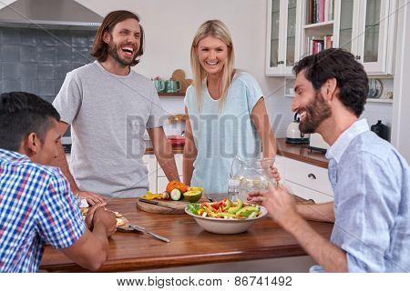 friends gathering party with salad and diversity in the kitchen