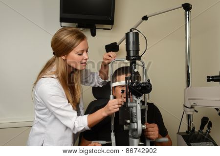 Young eye Doctor druring a test with patient in her office