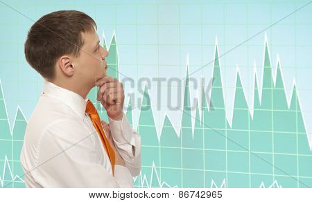 Stock trader looking at monitors