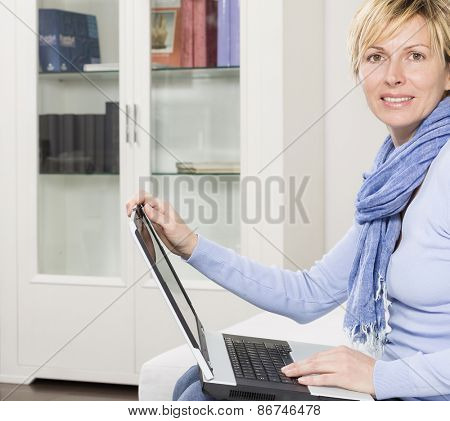 Forty years woman with computer notebook working from home