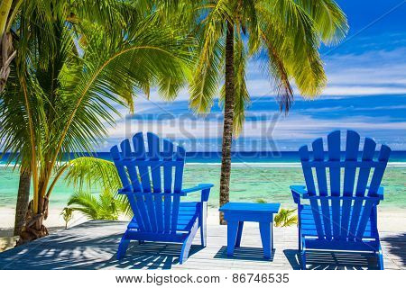 Two blue chairs on a beach front on amazing beach, Cook Islands