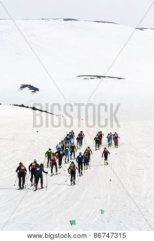 Group Ski Mountaineers Climb On Skis On Avacha Volcano. Team Race Ski Mountaineering. Kamchatka
