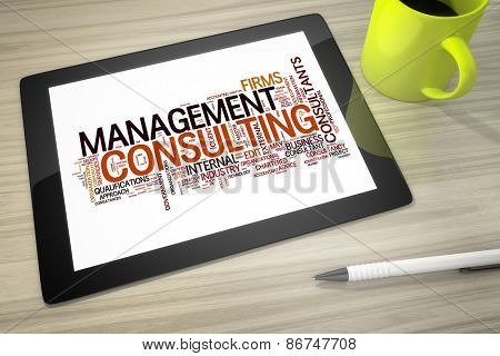 An image of a tablet pc with tag cloud management consulting