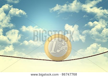 euro coin balance on rope