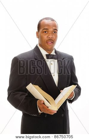 African American preacher reading from a bible, isolated over white