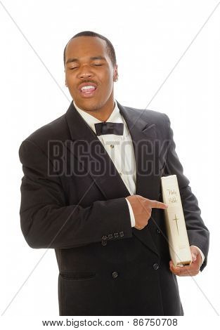 African American preacher holding and pointing at a bible, while preaching, isolated over white