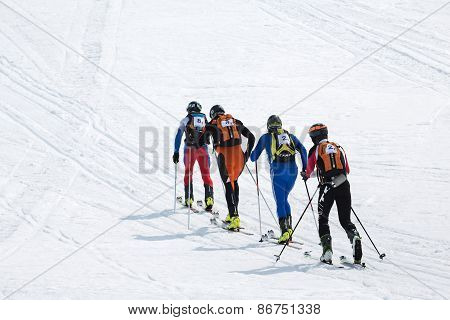 Two Teams Of Ski Mountaineers Climb The Mountain On Skis. Team Race Ski Mountaineering. Kamchatka