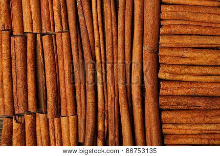 Cinnamon sticks on wooden background full frame